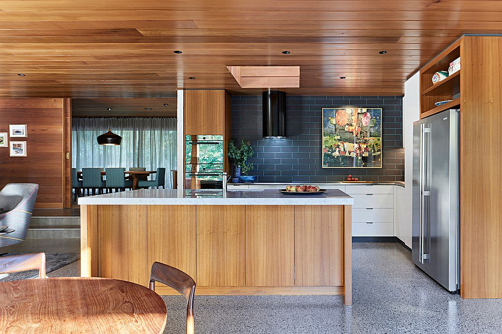 Colorful grout adds brightness to the gray backsplash in this polished kitchen