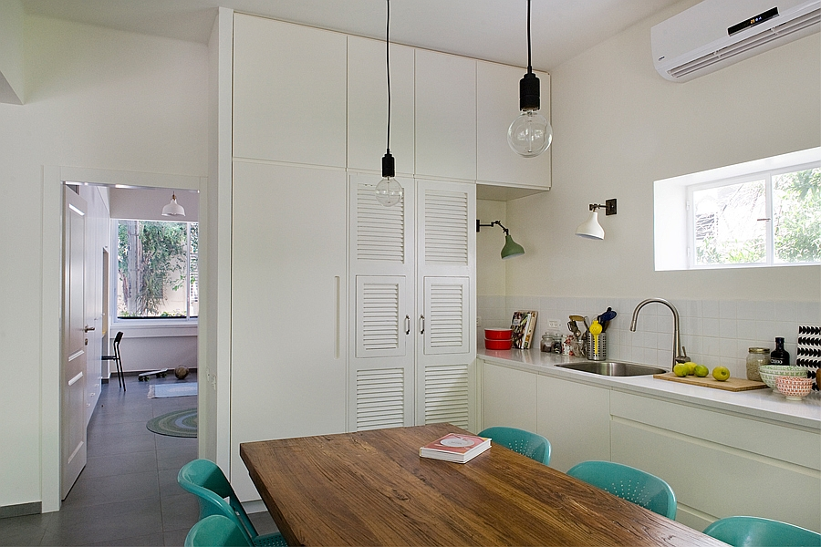 Combining the dining area with the single wall kitchen saves plenty of space