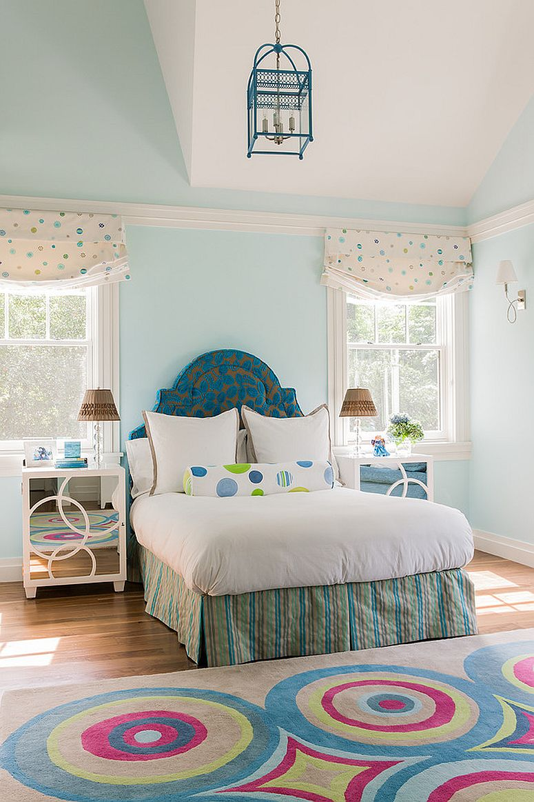 Contemporary bedroom in pastel blue with fun color pops
