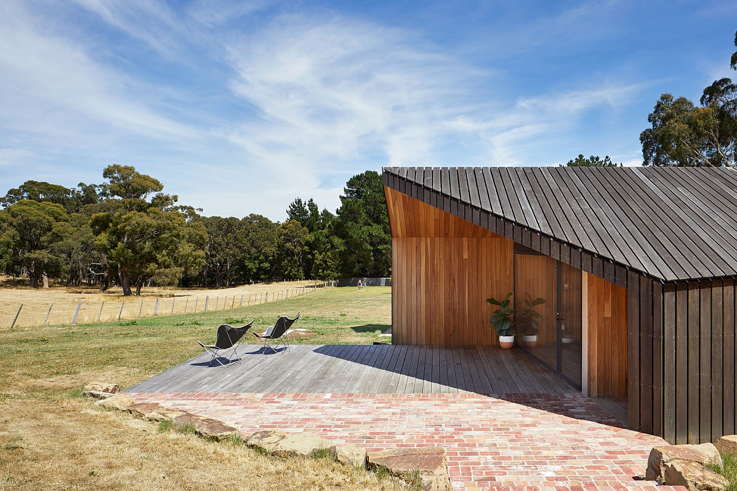 Contemporary-extension-with-rural-exterior-and-woodsy-charm
