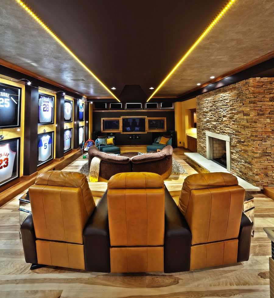 Contemporary home theater with framed baseball and basketball jerseys on the wall