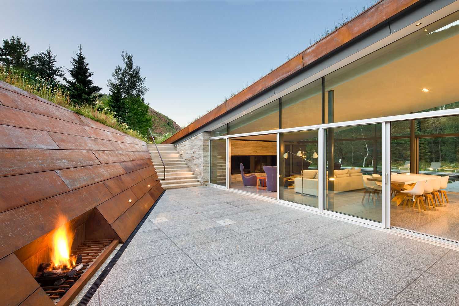 Corten clad walls provide textural contrast and warmth to the patio