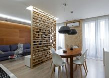 Custom-plywood-partition-delineates-living-room-from-the-dining-area-in-this-small-apartment-217x155