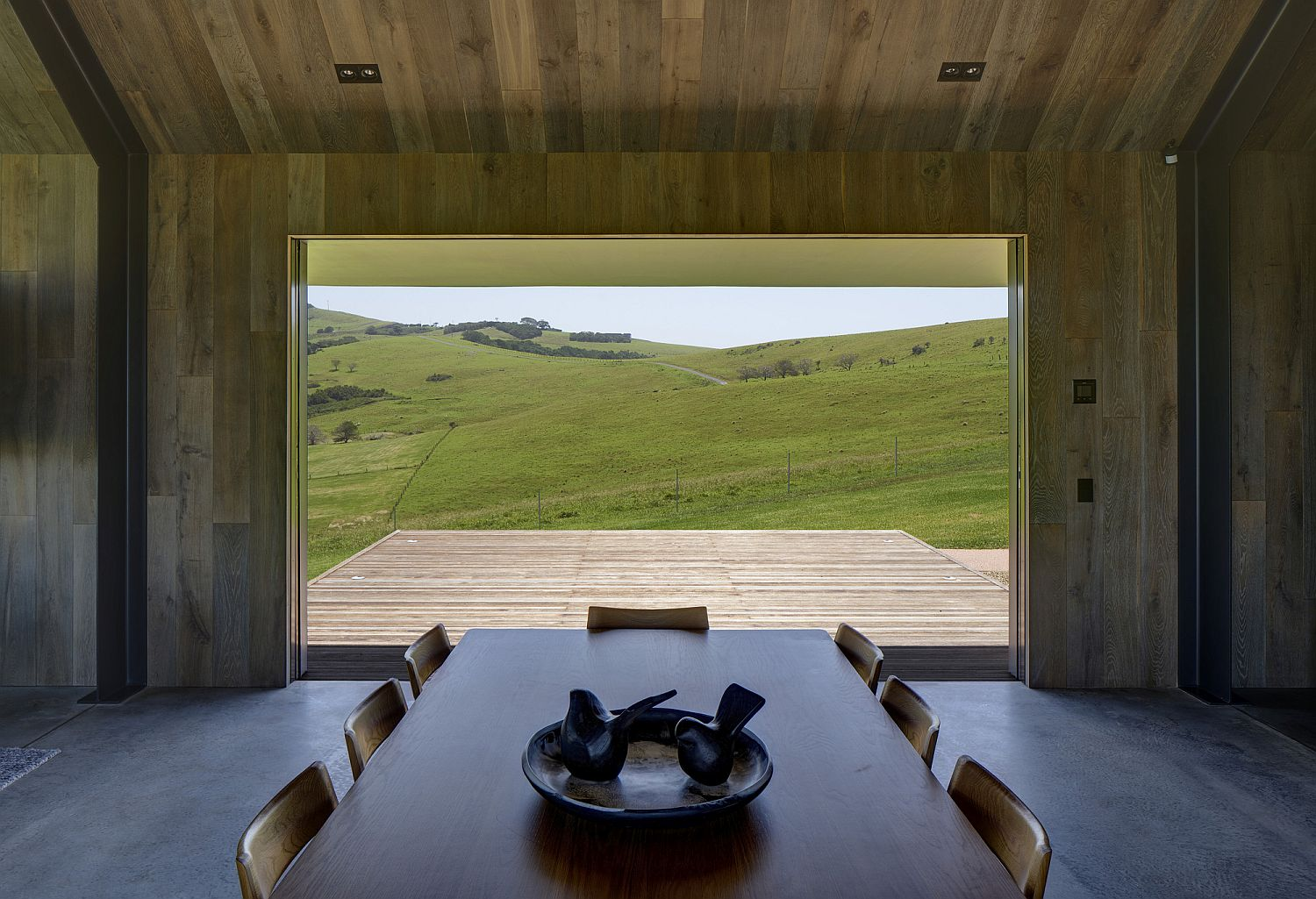Deck with a view of the pastoral lands opposite the one with ocean views