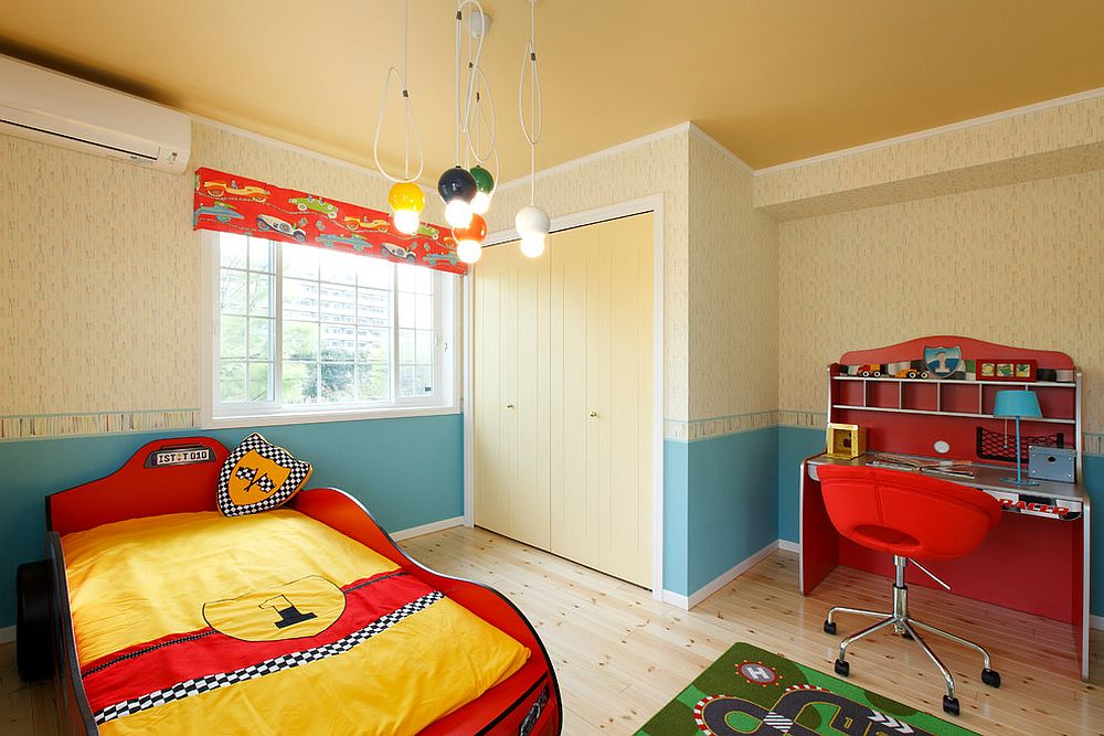Delightful boys' bedroom in yellow with red accents