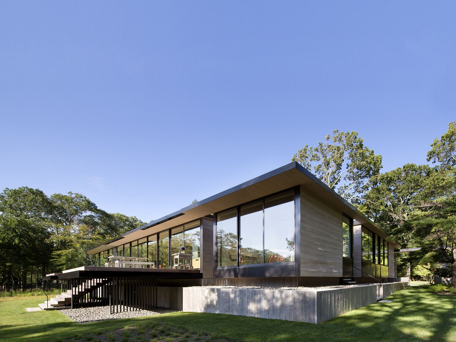 Different terraces and surfaces around the elevated house provide smart outdoor spaces