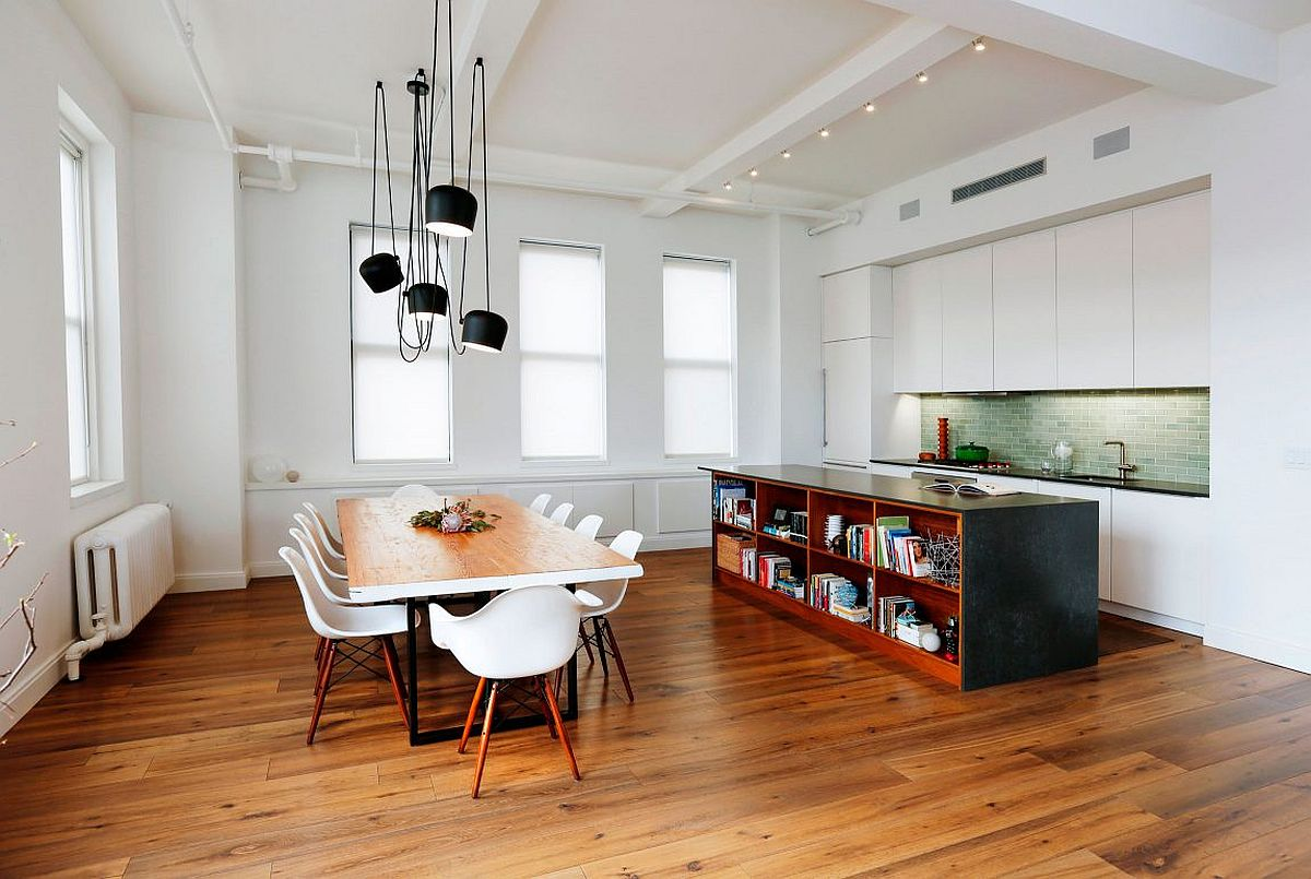 Dining area and kitchen rolled into one inside the small NYC loft