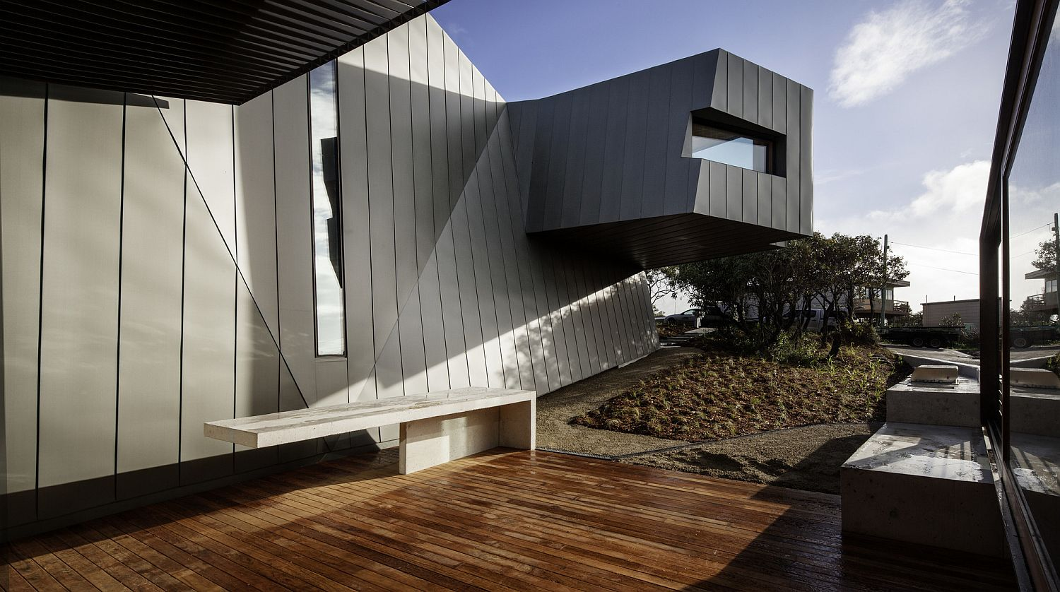 Dramatic cantilevered study of the beach house in gray