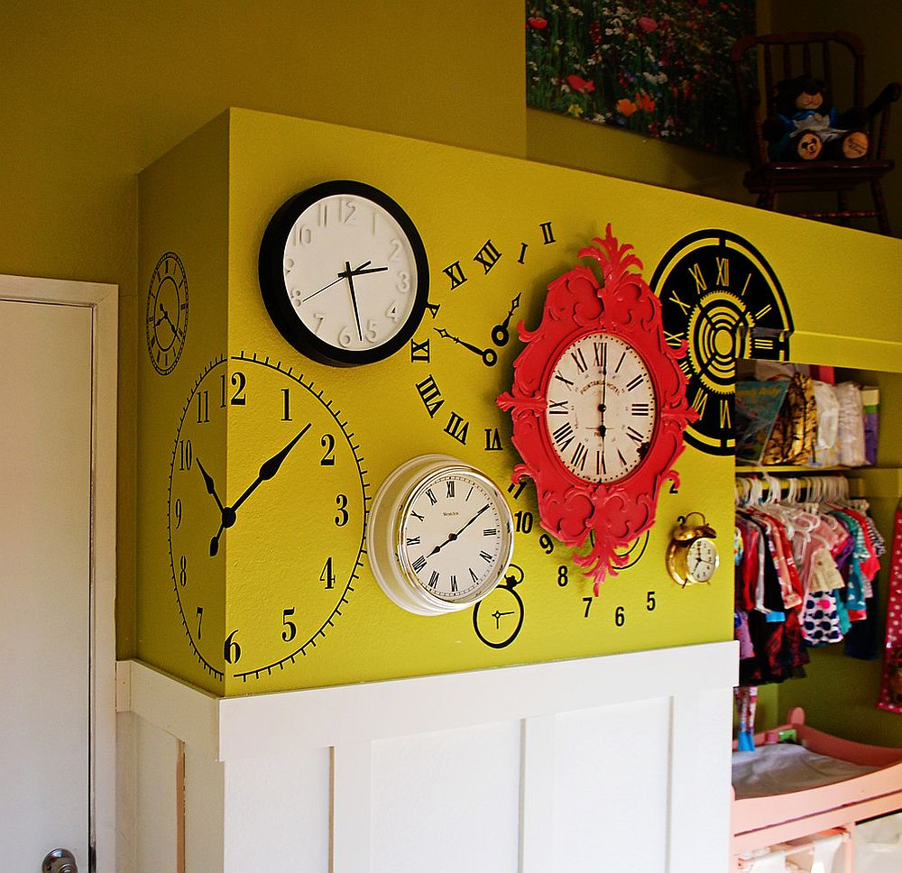 Eclectic collection of wall clocks in the kids' room along with wall murals