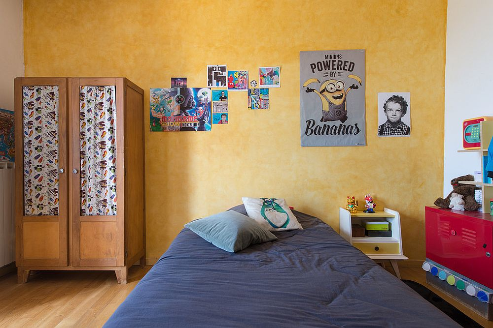 Eclectic kids' room with yellow accent wall