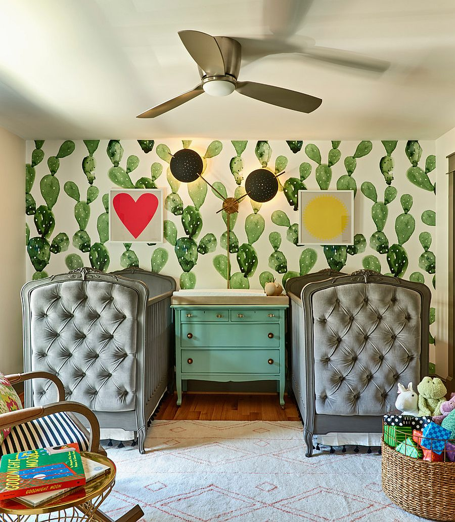 Eclectic nursery with wallpaper that carries cactus motif