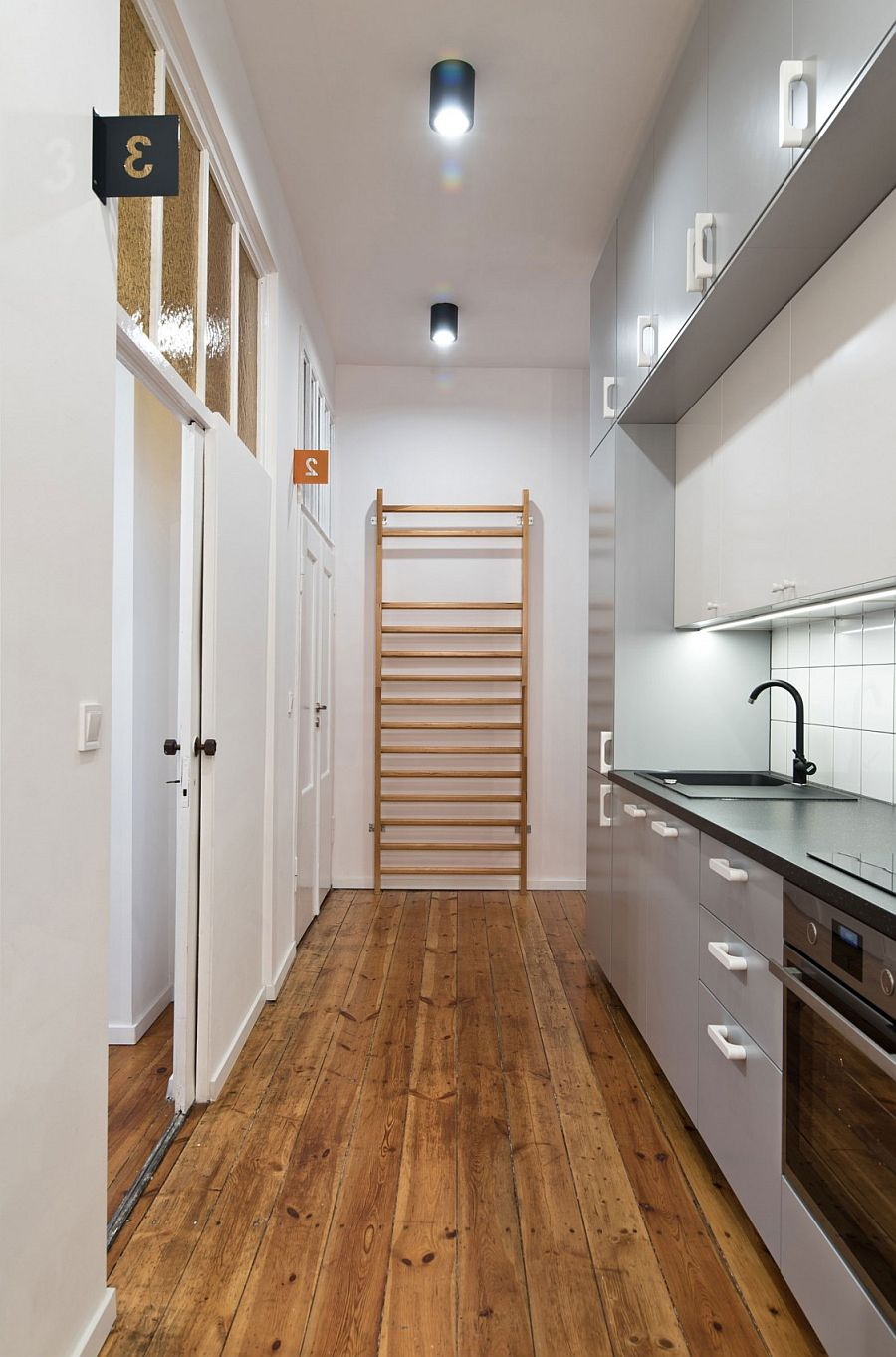 Even the long hallway can be turned into kitchen in the tiny apartment using a smart counter
