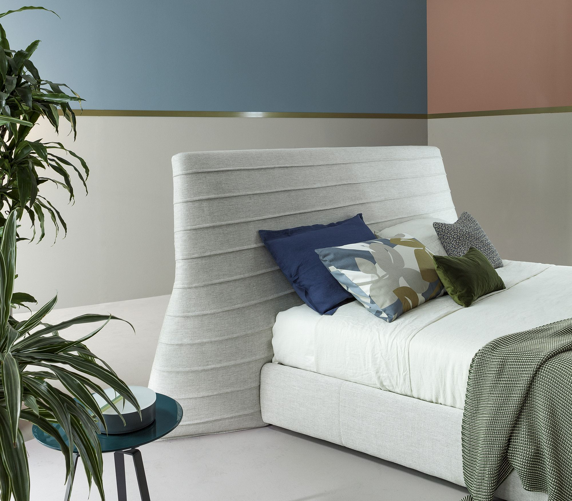 Fabric-covered-headboard-of-the-bed-gives-it-a-unique-look
