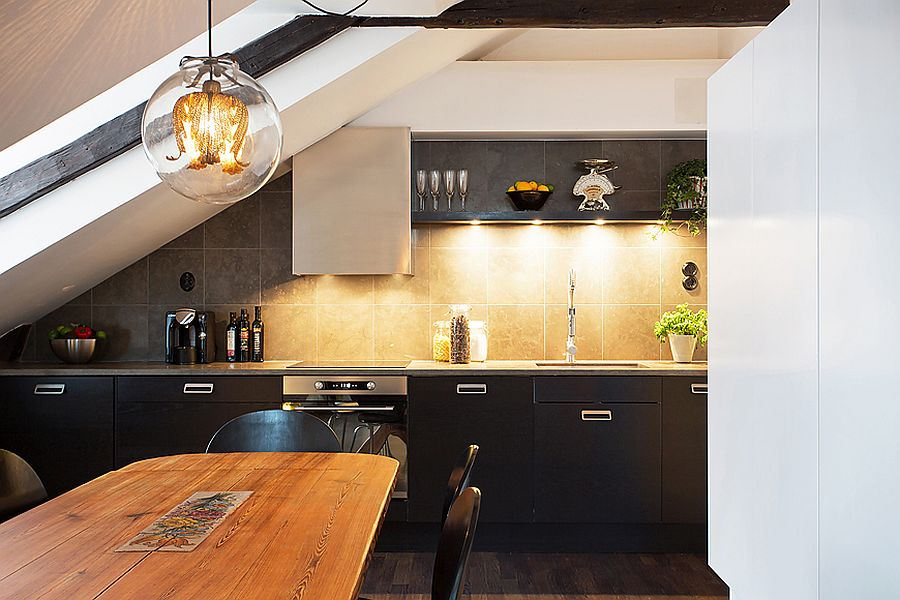 Find a smart niche for the modern kitchen inside the small attic apartment