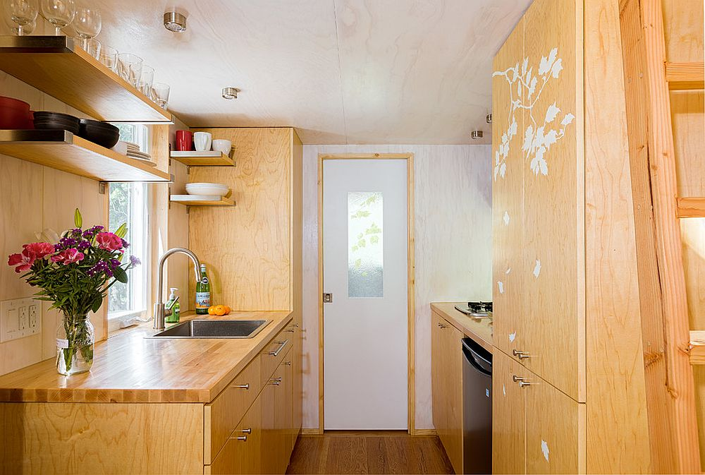 Floating-wooden-shelves-at-the-top-add-to-the-storage-capacity-of-the-kitchen