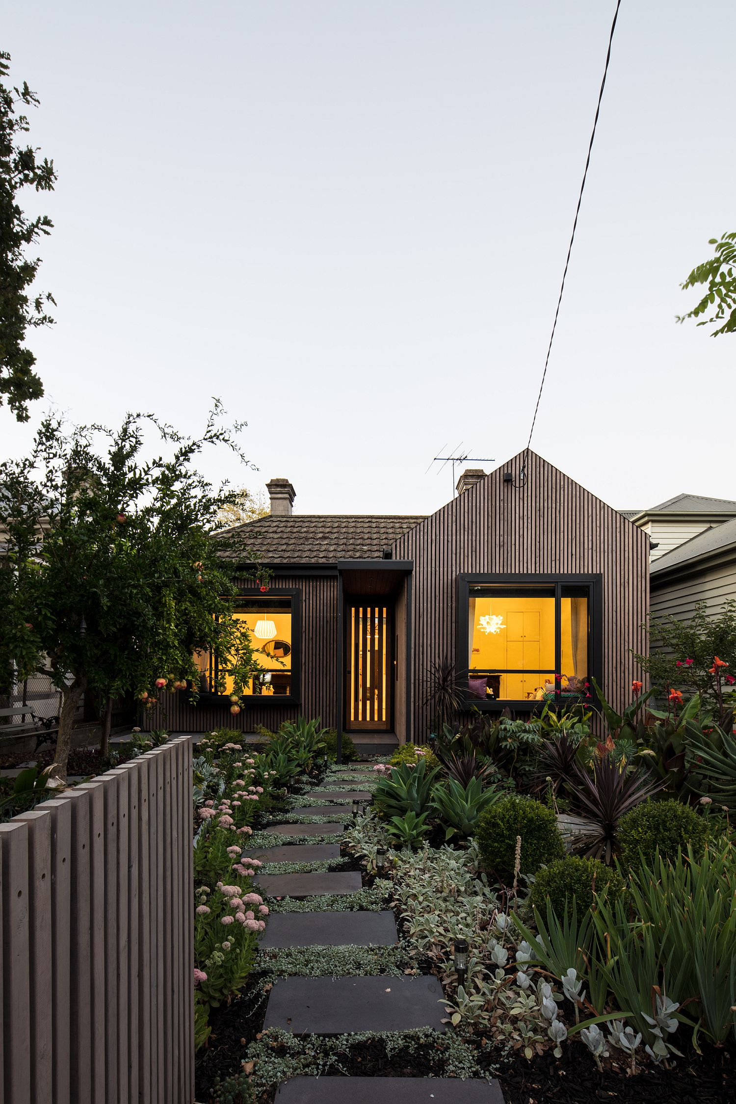 Gorgeous green garden and a modern entry revamp the old Victorian residence