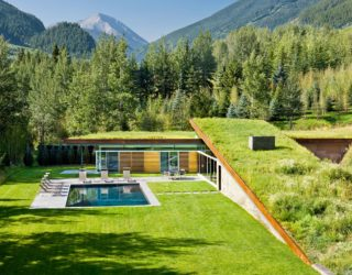 Camouflaged in a Cloak of Green: Majestic Eco-Friendly House in the Mountains