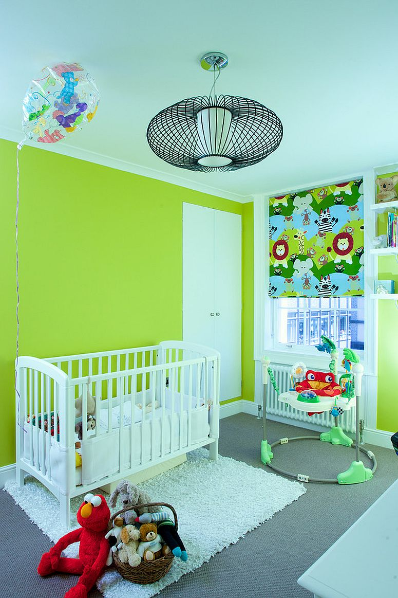 Green jungle-themed nursery with plenty of blue