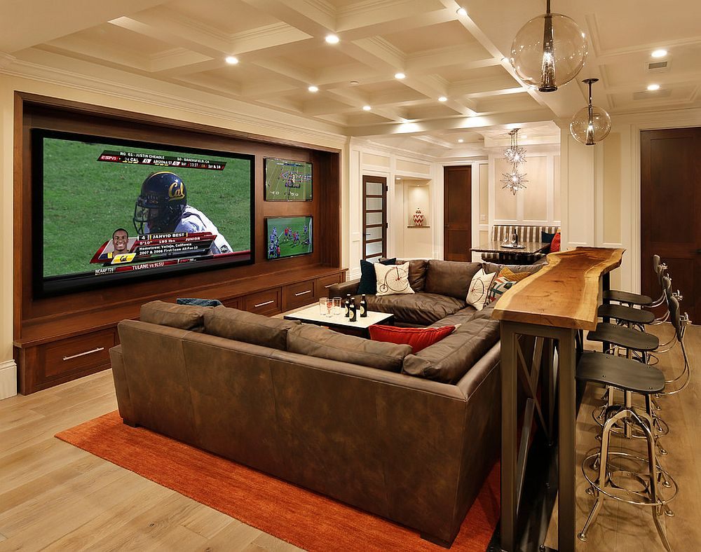 Home theater with multiple TVs and screens for the avid sports fan