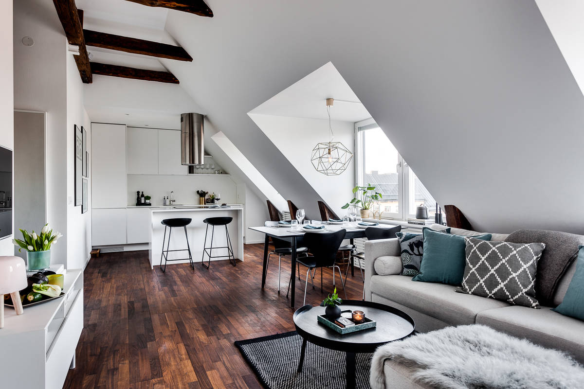 Kitchen at the end of the open plan living space inside the small attic apartment