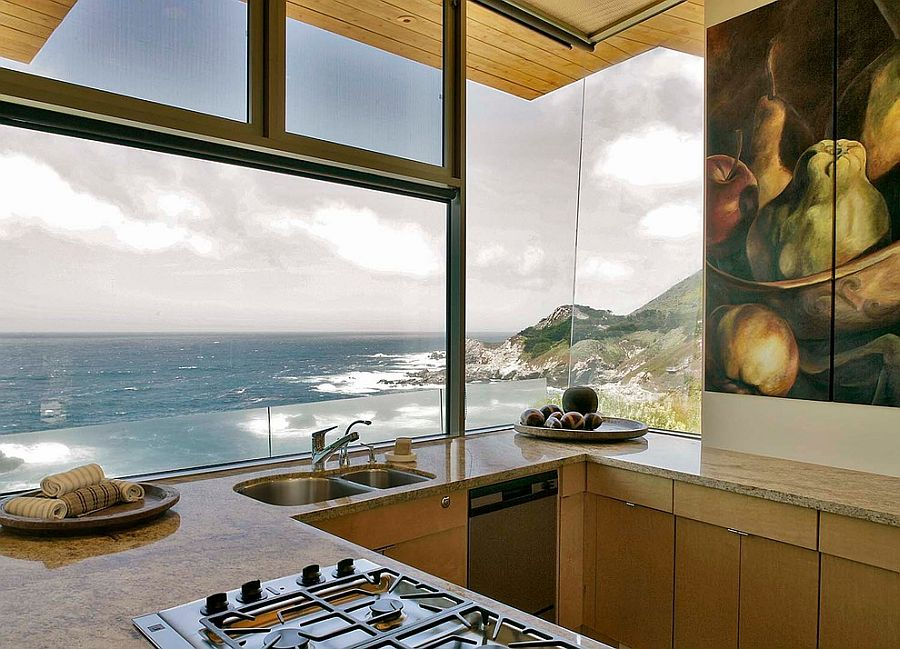 Kitchen captures the view of the rocky coastline and waves in the distance