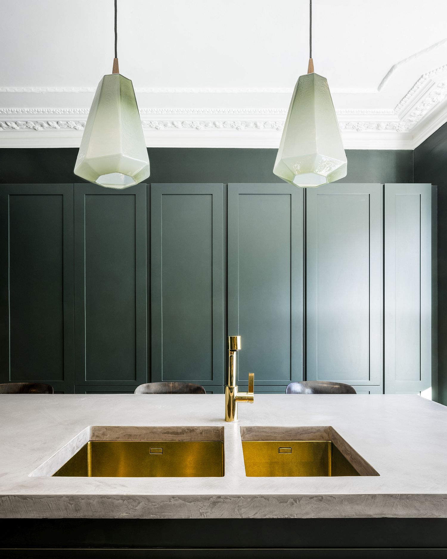 Kitchen fixtures add metallic glint to the polished interior