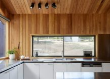 Kitchen-window-above-the-counter-offers-views-of-the-landscape-outside-217x155