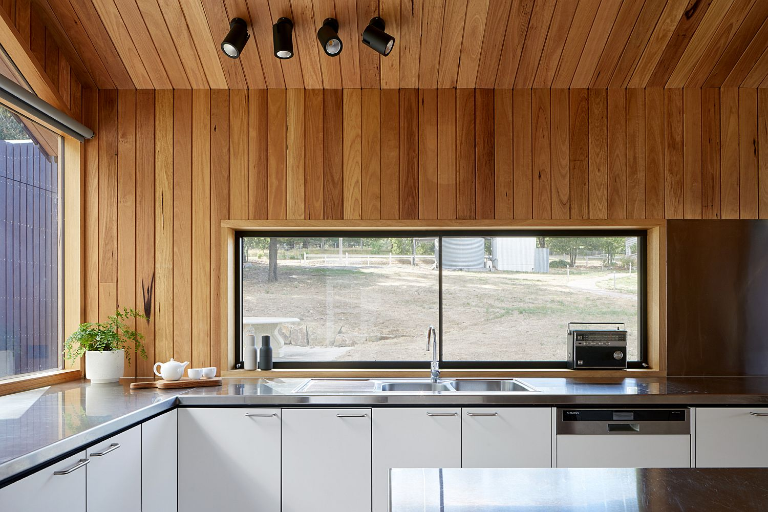 Kitchen-window-above-the-counter-offers-views-of-the-landscape-outside