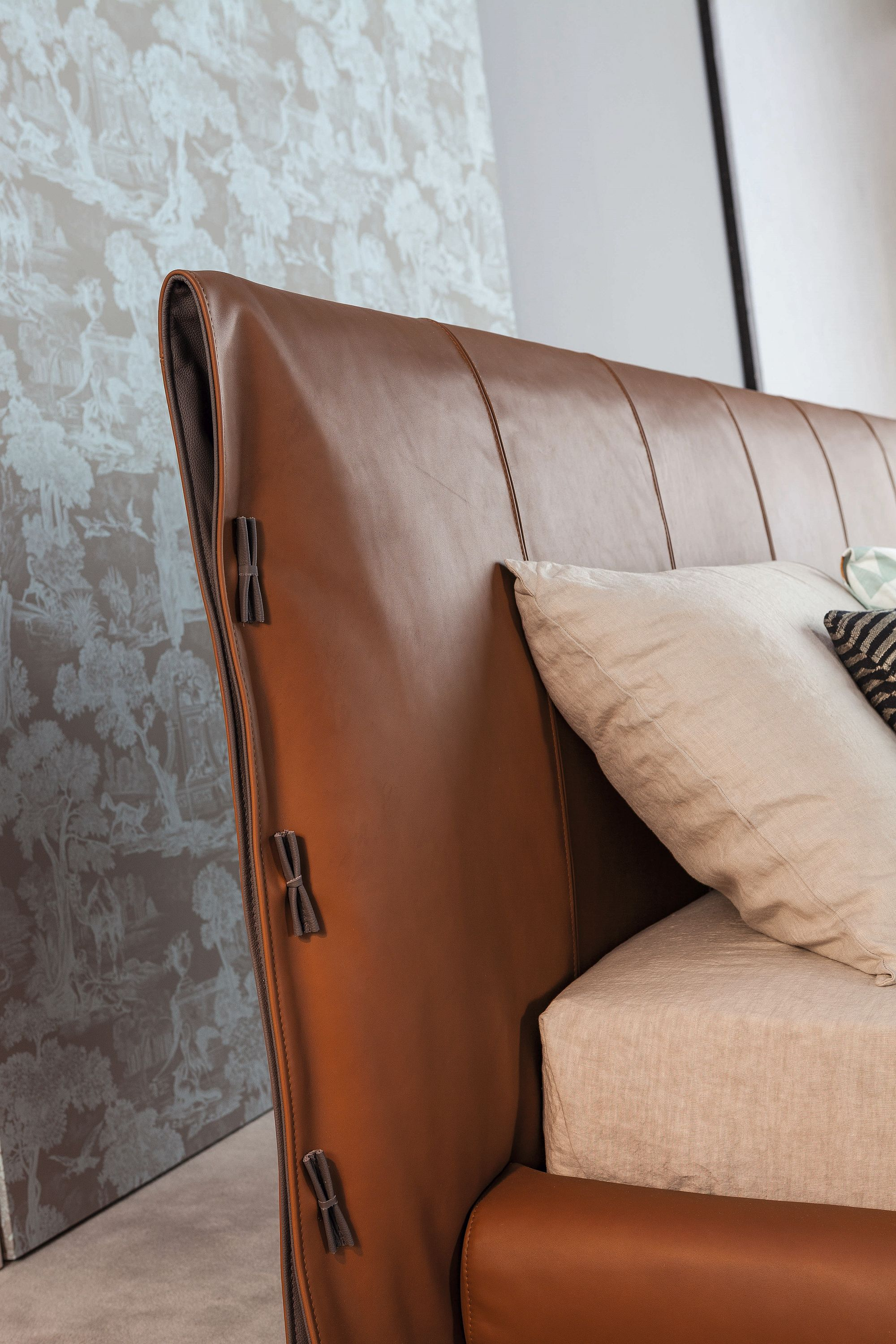Leather gives the bed a polished, contemporary vibe