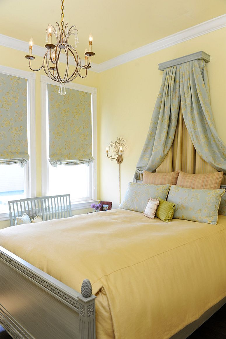 Light yellow gives the bedroom a soothing backdrop