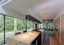 Long-kitchen-island-in-black-with-a-cool-wooden-breakfast-nook-and-dining-zone-next-to-it-217x155