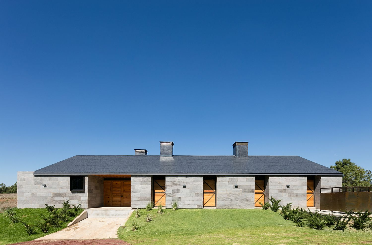 Modern-Mexican-ranch-house-with-a-gray-exterior-in-volcanic-rock