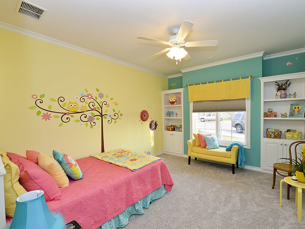 Modern eclectic kids' room in yellow and blue with a smart wall mural