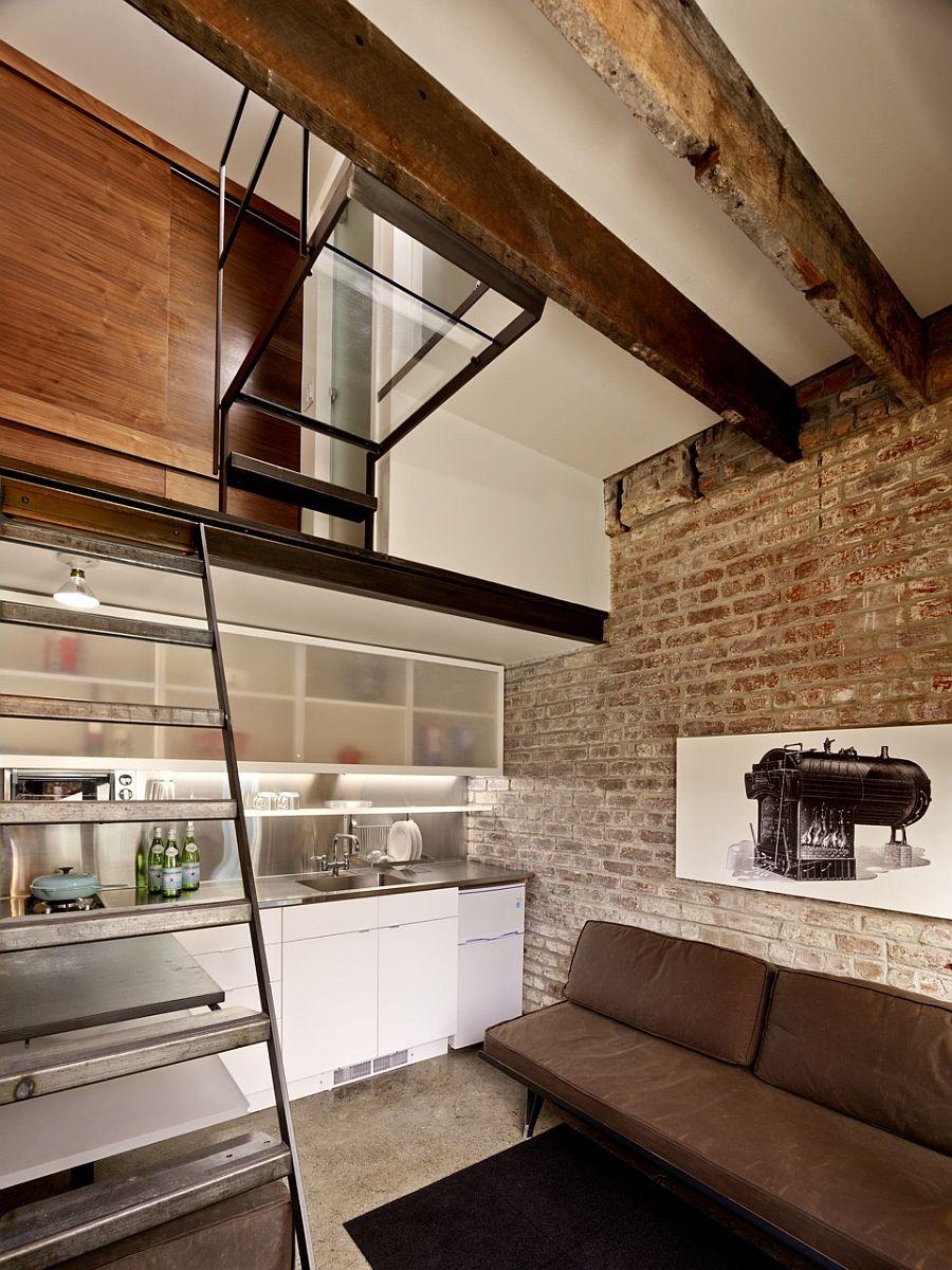 Modern kitchen under the mezzanine level bedroom is a smart space saver
