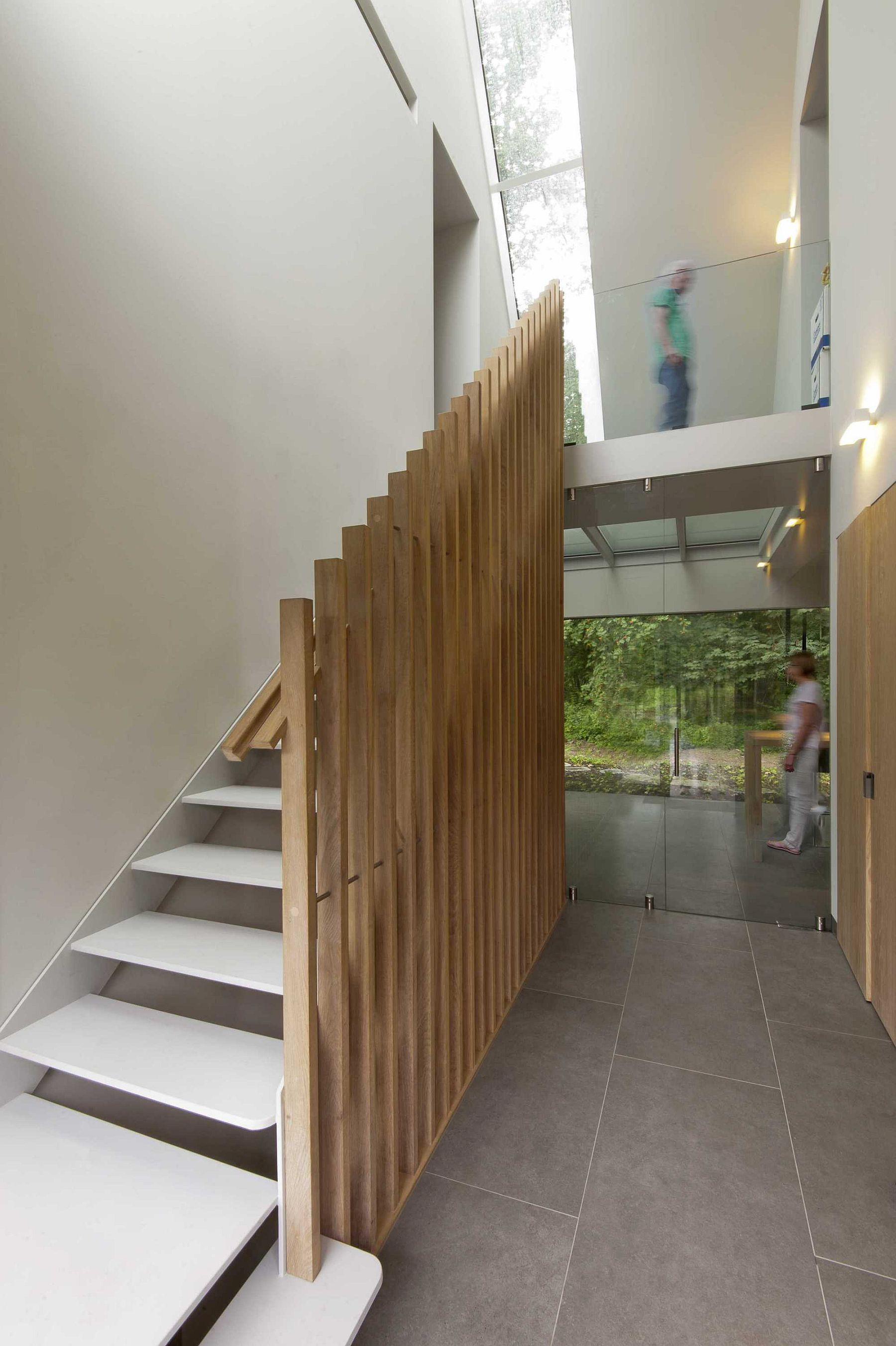 Modified wooden slats used as railing for staircase inside the house