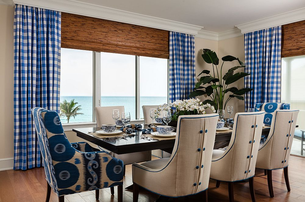 Natural woven shades coupled with blue plaid drapes in the dining room