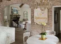 Open-shabby-chic-living-area-with-lovely-brick-wall-backdrop-217x155