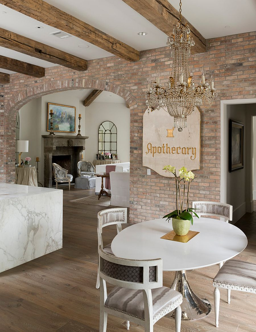 Open shabby chic living area with lovely brick wall backdrop