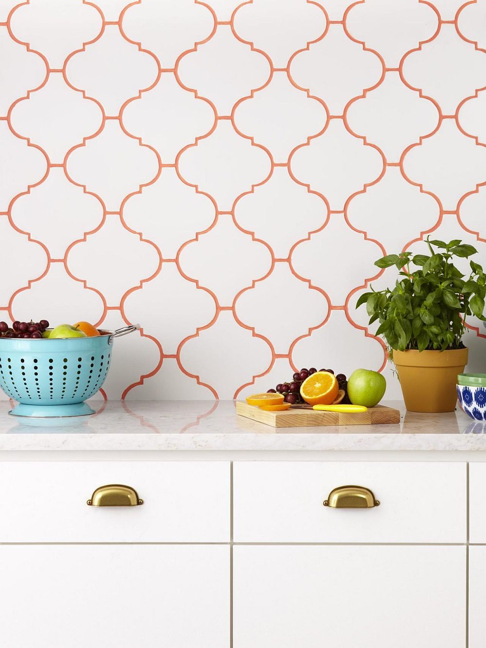 Orange grout lines for tile in white with a touch of flowery pattern