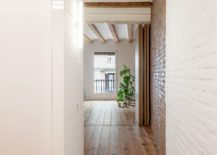 Painted-brick-walls-and-exposed-ceilings-beams-give-the-apartment-a-traditional-look-217x155