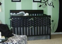 Painted-tree-wall-mural-accentuates-stripes-on-the-wall-in-the-nursery-217x155