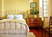 Painted-yellow-brick-wall-in-the-shabby-chic-bedroom-217x155