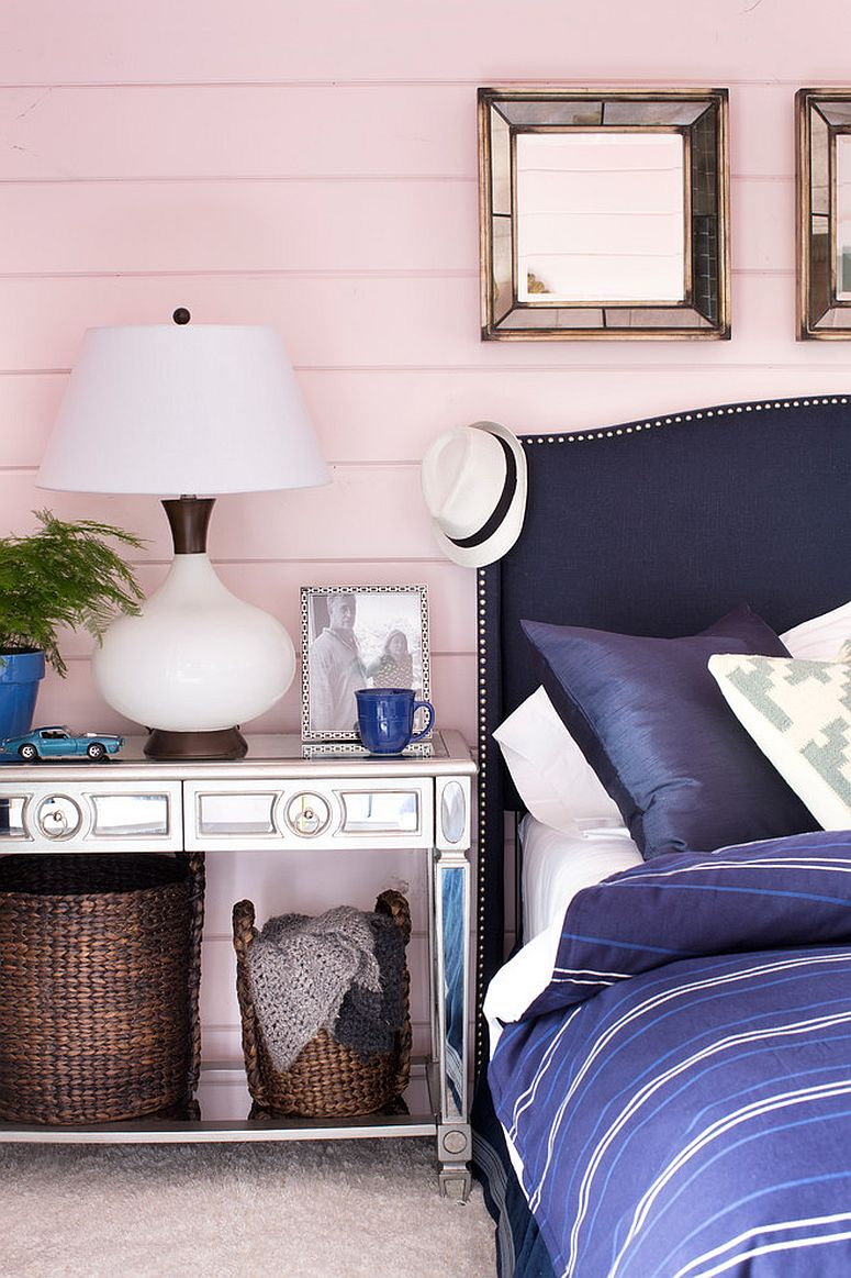 Pastel pink provides the perfect backdrop for bedroom with blue bedding and decor