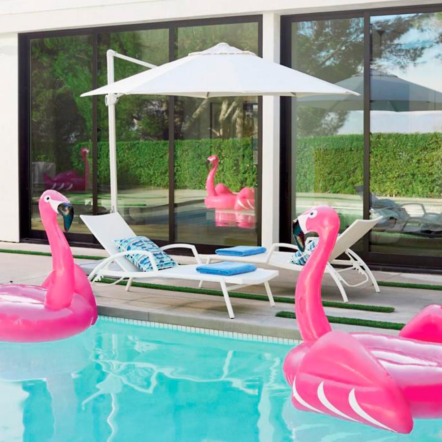 Patio umbrellas and flamingo floaties
