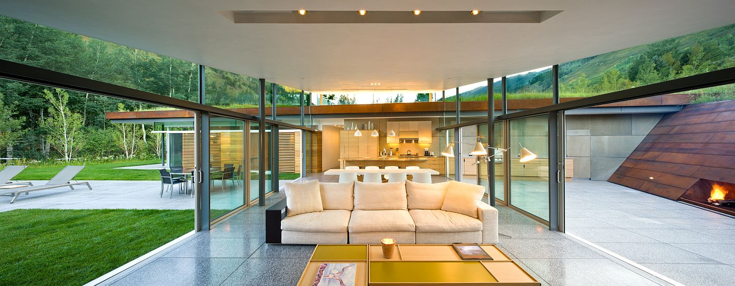 Pavilion style sitting area surrounded by glass walls and sliding glass doors