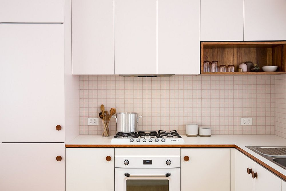 Pink grout adds to the gentle pinkish hue of the midcentury kitchen
