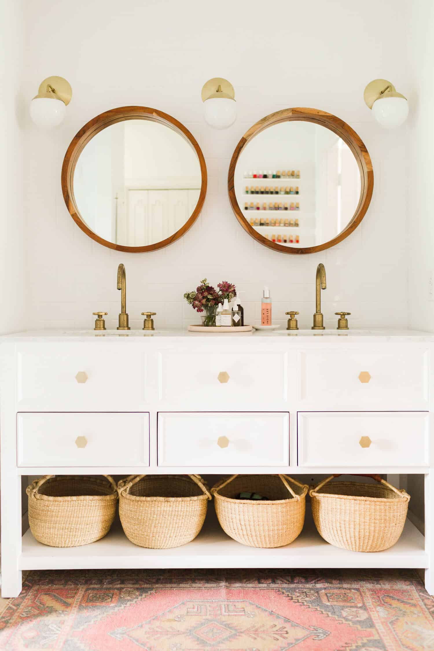 Row of storage baskets in a remodeled bathroom