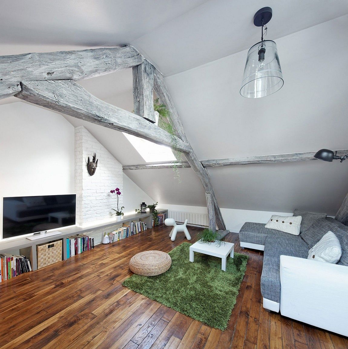 Rustic-modern attic apartment with living room in white