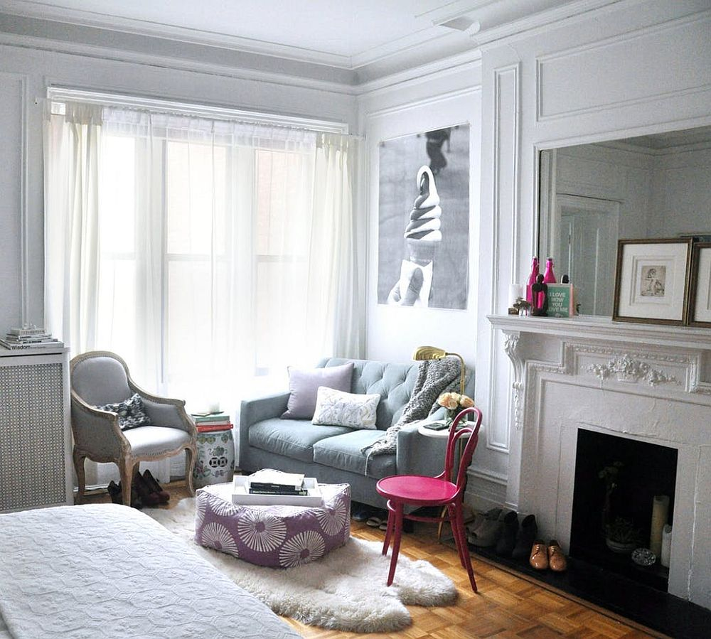 Shabby chic living space of tiny apartment with pops of pink
