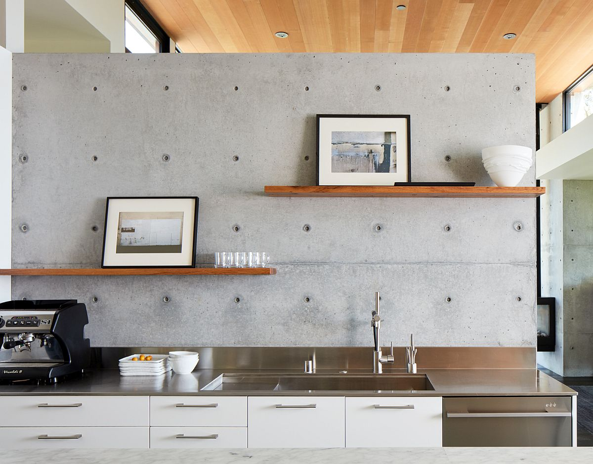 Single-wall kitchen idea with a concrete wall